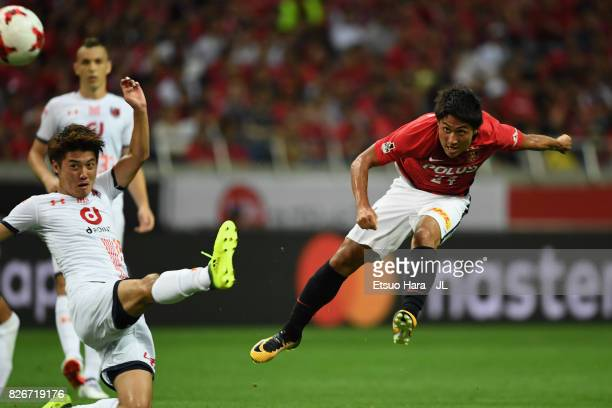 Takahiro Sekine of Urawa Red Diamonds shoots at goal during the JLeague J1 match between Urawa Red Diamonds and Omiya Ardija at Saitama Stadium on...