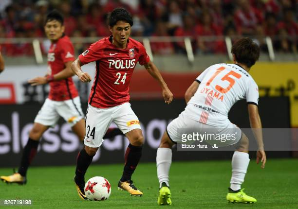Takahiro Sekine of Urawa Red Diamonds takes on Keisuke Oyama of Omiya Ardija during the JLeague J1 match between Urawa Red Diamonds and Omiya Ardija...