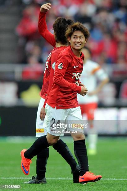 Takahiro Sekine of Urawa Reds celebrates scoring his team's first goal during the JLeague match between Urawa Red Diamonds and Nagoya Grampus at...