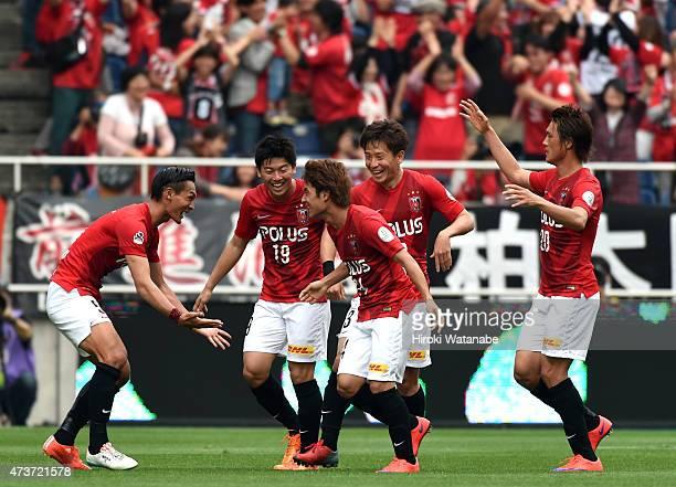 Takahiro Sekine of Urawa Reds celebrates scoring his team's second goal with his team mates during the JLeague match between Urawa Red Diamonds and...