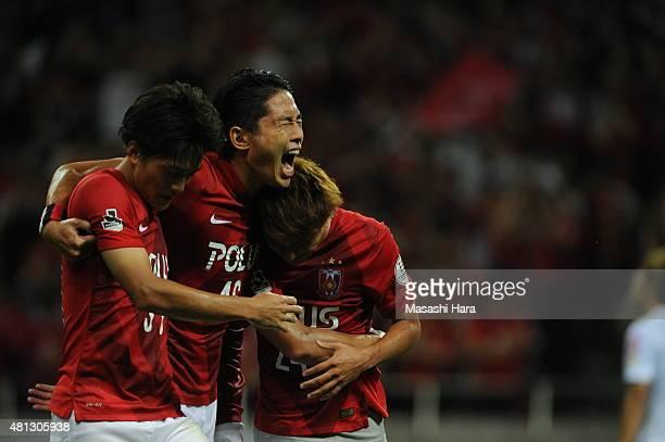 Takahiro Sekine Ryota Moriwaki and Toshiyuki Takagi of Urawa Red Diamonds celebrate the first goal during the JLeague match between Urawa Red...