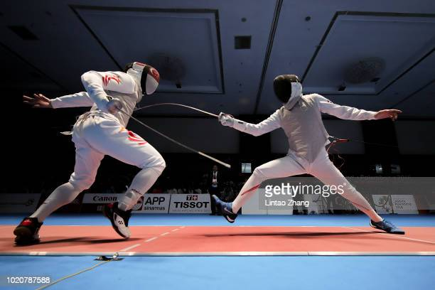Takahiro Shikine of Japan competes against Kevin Jerrold Chan of Singapore during the Men's Foil Individual Round of fencing event on day three of...
