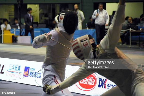 Takahiro Shikine of Japan competes in the Men's Team Foil semi final against United States during day three of the Fencing Prince Takamado Trophy at...
