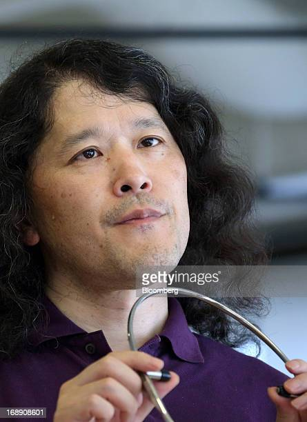Takahito Iguchi chief executive officer of Telepathy Inc holds a mockup of the company's Telepathy One wearable device in Tokyo Japan on Tuesday May...