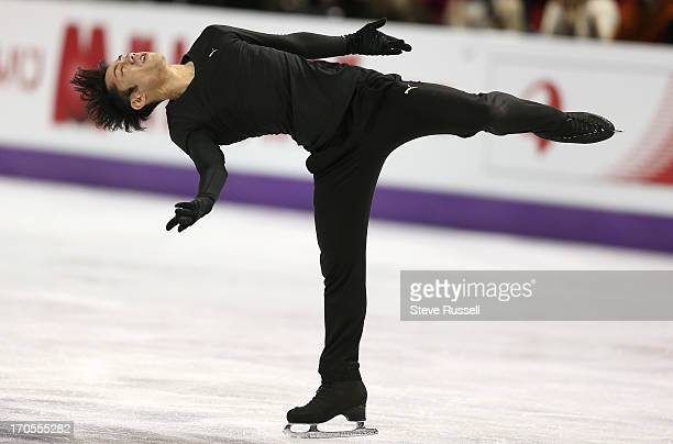 Takahito Mura from Japan spins as skaters practice to compete in the ISU World Figure Skating Championships at Budweiser Gardens.