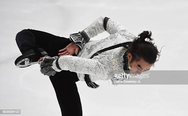 Takahito Mura of Japan competes in the men's short program at the US International Figure Skating Classic Day 1 at the Salt Lake City Sports Complex...