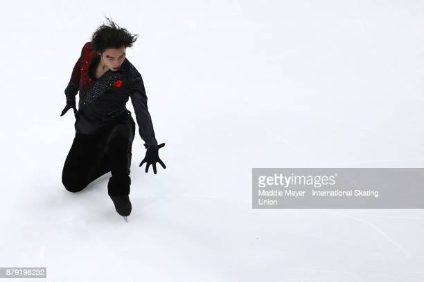 Takahito Mura of Japan performs in the Mens Free Skate program on Day 2 of the ISU Grand Prix of Figure Skating at Herb Brooks Arena on November 25...