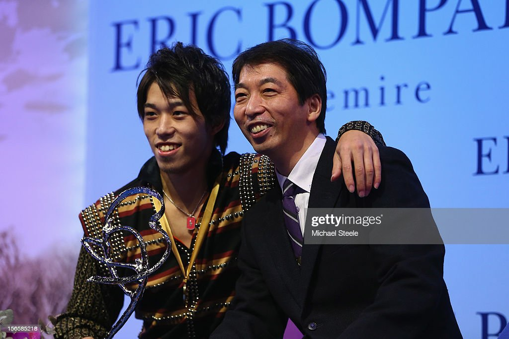 Takahito Mura (L) of Japan poses with his father and coach Takashi Mura (R) after winning the gold medal and overall victory after the Men's Free Skating program and overall victory on day two of the ISU Grand Prix of Figure Skating Trophee Eric Bompard at Omnisports Bercy on November 17, 2012 in Paris, France.