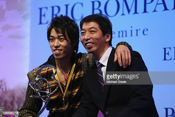 Takahito Mura of Japan poses with his father and coach Takashi Mura after winning the gold medal and overall victory after the Men's Free Skating...