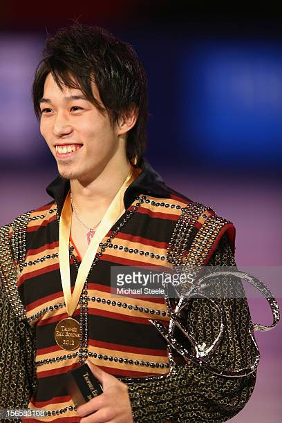 Takahito Mura of Japan with the winners trophy and gold medal after the Men's Free Skating program and overall victory on day two of the ISU Grand...