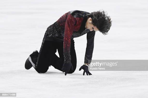 Takahito Mura reacts after performing in the men's free skate at the national figure skating championships at Musashino Forest Sport Plaza in Chofu...