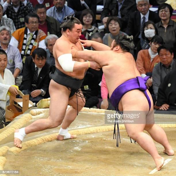 Takakeisho pushes Mongolian yokozuna Harumafuji to win during day two of the Grand Sumo Kyushu Tournament at Fukuoka Convention Center on November 13...
