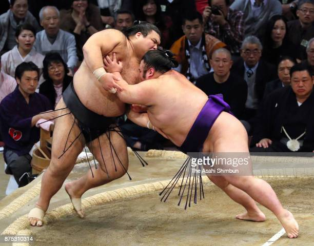 Takakeisho pushes ozeki Takayasu out of the ring to win during day six of the Grand Sumo Kyushu Tournament at Fukuoka Convention Center on November...