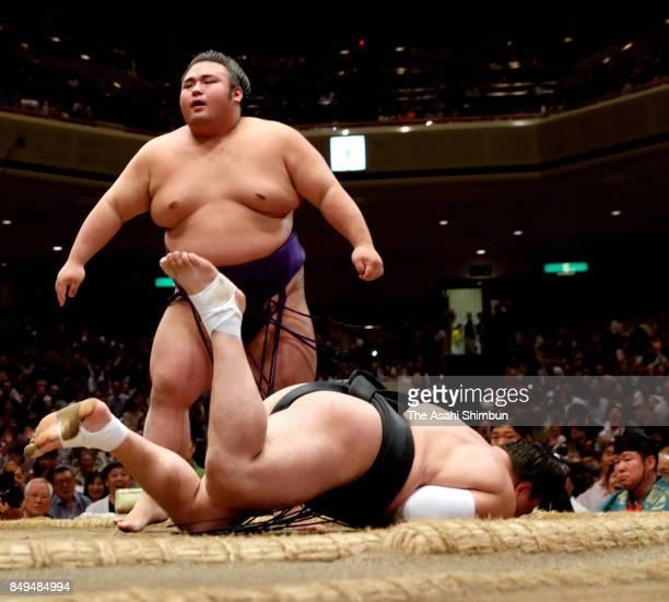 Takakeisho reacts after his victory over Mongolian yokozuna Harumafuji during day ten of the Grand Sumo Autumn Tournament at Ryogoku Kokugikan on...
