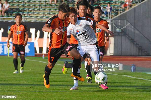 Takaki Fukumitsu of Renofa Yamaguchi and Naoki Kawaguchi of Shimizu S-Pulse compete for the ball during the J.League second division match between...