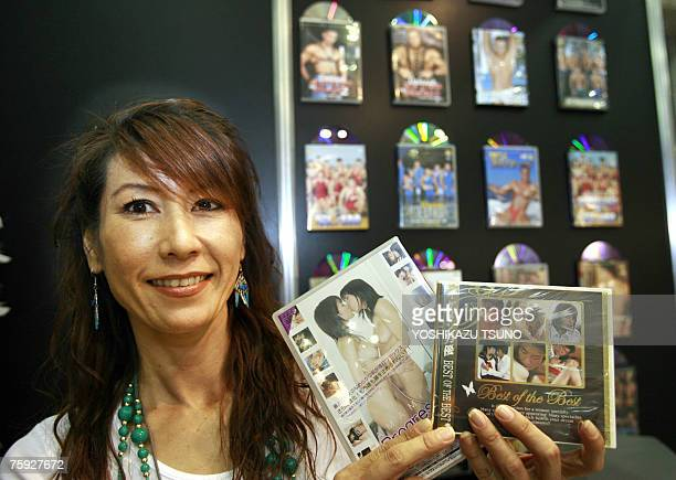 Takako Kimura manager of an adult video software provider Hotesseshop shows packages of adult movies for women at the Adult Treasure Expo in Makuhari...