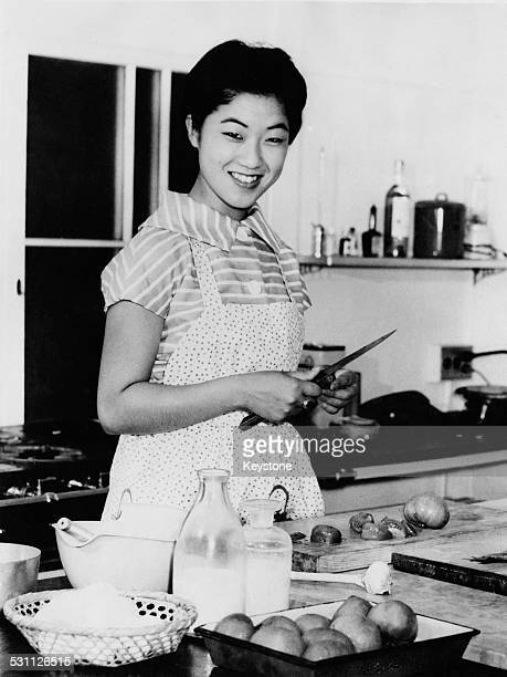 Takako Princess Suga the youngest daughter of Emperor Hirohito of Japan preparing a meal days before her marriage to financial analyst Hisanaga...