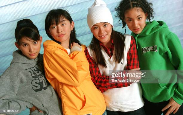 Takako Uehara Hiroko Shimabukuro Eriko Imai and Hitoe Arakaki of Japanese vocal/dance group SPEED pose for photographs on October 6 1997 in Tokyo...