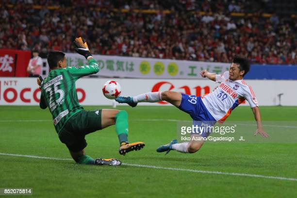 Takamitsu Tomiyama of Albirex Niigata and Gu Sung Yun of Consadole Sapporo compete for the ball during the JLeague J1 match between Consadole Sapporo...