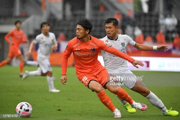 Takamitsu TOMIYAMA of Omiya Ardija and Kazuki SEGAWA of Tochigi SC battle for the ball during the J.League Meiji Yasuda J2 match between Omiya Ardija...