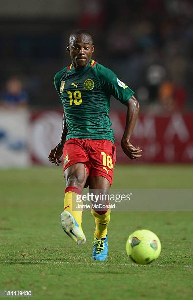 Takang Enough Eyong of Cameroon in action during the FIFA 2014 World Cup qualifier at the Stade Olympique de Radès on October 13 2013 in Rades Tunisia