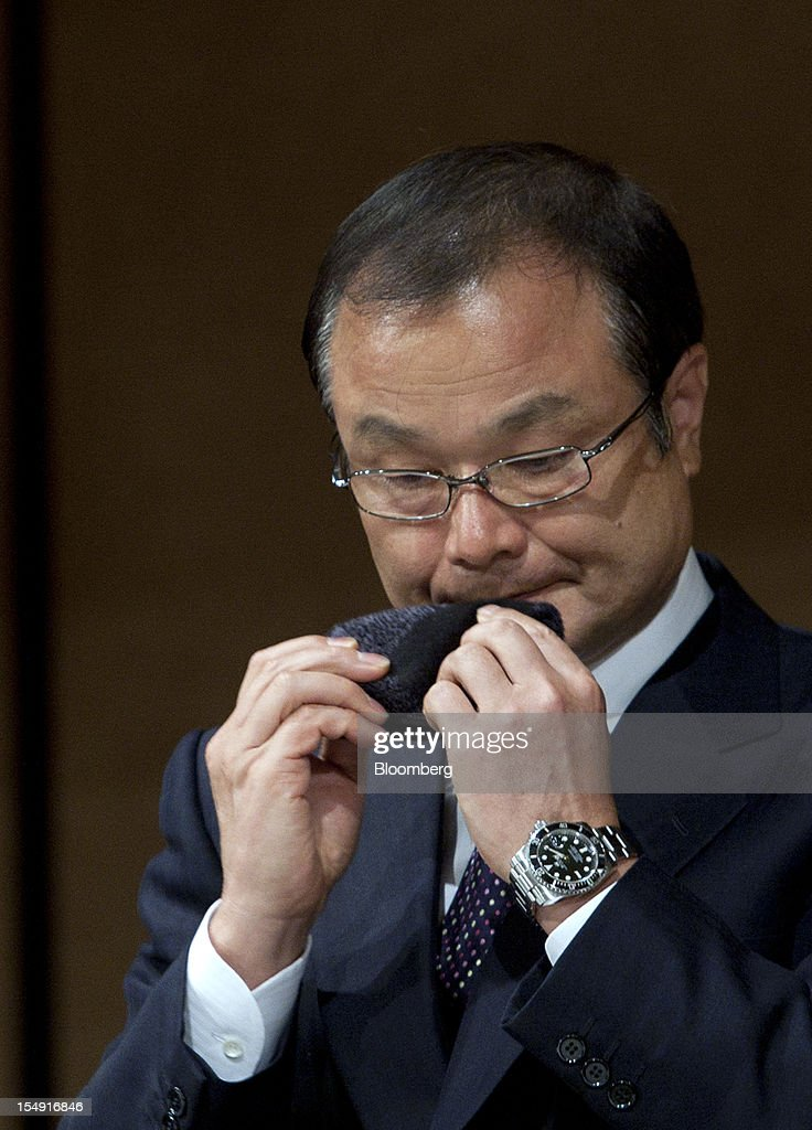 Takanobu Ito, chief executive officer of Honda Motor Co., uses a handkerchief to wipe his face during a joint news conference hosted by the Japan Automobile Manufacturers Association Inc. (JAMA) in Tokyo, Japan, on Monday, Oct. 29, 2012. Toyota and other Japanese carmakers reiterated their call for the government to scrap vehicle taxes to spur domestic demand. Photographer: Tomohiro Ohsumi/Bloomberg via Getty Images