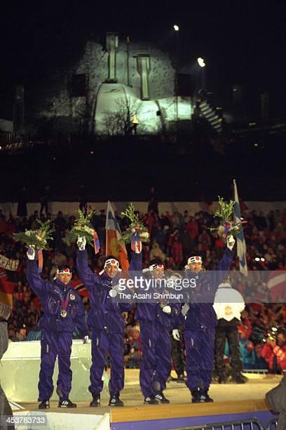 Takanobu Okabe Noriaki Kasai Masahiko Harada and Jinya Nishikata of Japan celebrate winning the silver in the Ski Jumping Team competition during the...