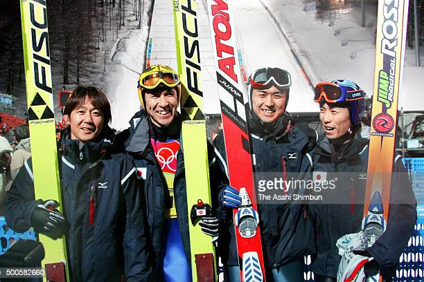 Takanobu Okabe Noriaki Kasai Tsuyoshi Ichinohe and Daiki Ito of Japan team pose for photographs after the Ski Jumping Men's Team on day ten of the...