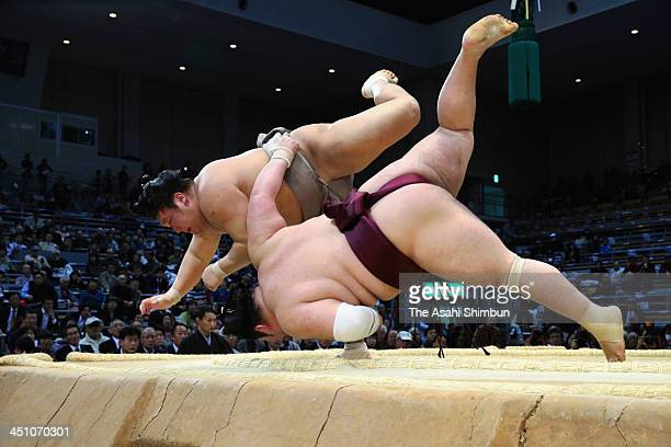 Takanoiwa throws Tokusyoryu to win during the day nine of the Grand Sumo Kyushu Tournament at Fukuoka Convention Center on November 18 2013 in...