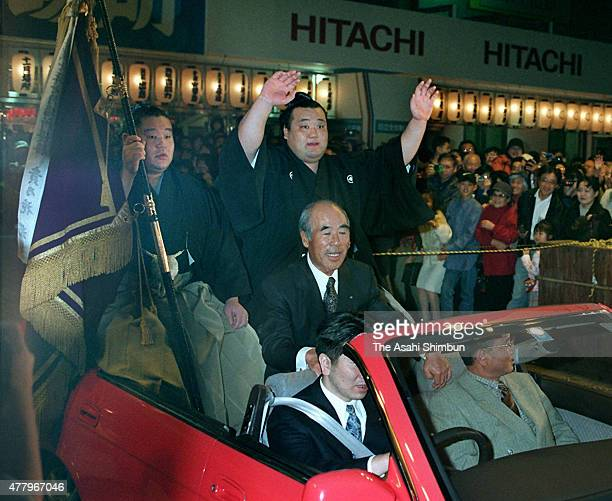 Takanonami celebrates during the winner's parade after winning the Grand Sumo Kyushu Tournament at Fukuoka Convention Center on November 23 1997 in...