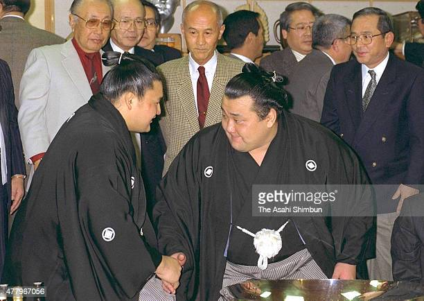 Takanonami is congratulated by Takanohana after winning the Grand Sumo New Year Tournament at Futagoyama Stable on January 21 1996 in Tokyo Japan