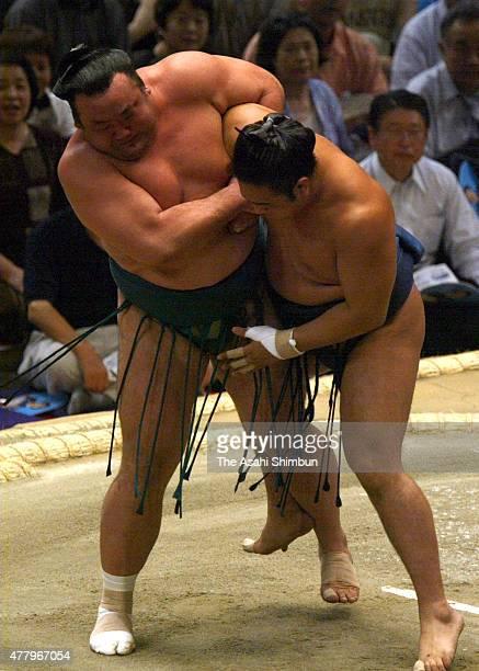Takanonami throws Aminishiki to win during day six of the Grand Sumo Nagoya Tournament at Aichi Prefecture Gymnasium on July 12 2002 in Nagoya Aichi...