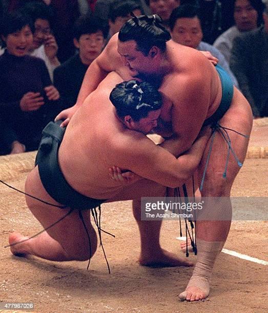 Takanonami throws Takanohana to win the championship via playoff during day fifteen of the Grand Sumo Kyushu Tournament at Fukuoka Convention Center...