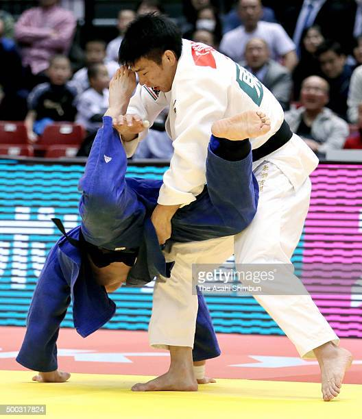 Takanori Nagase of Japan commits a foul by grabbing a leg of Lee Seungsu of South Korea in the Men's 81kg semi final during day two of the Judo Grand...