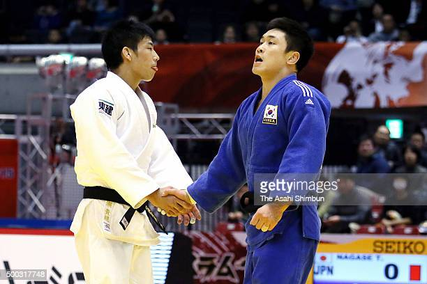Takanori Nagase of Japan reacts after losing by committing a foul in the Men's 81kg semi final against Lee Seungsu of South Korea during day two of...