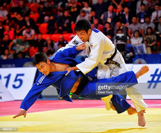 Takanori Nagase of Japan throws SeungSu Lee of South Korea without a score eventually winning the contest by a penalty against Lee with Japan winning...