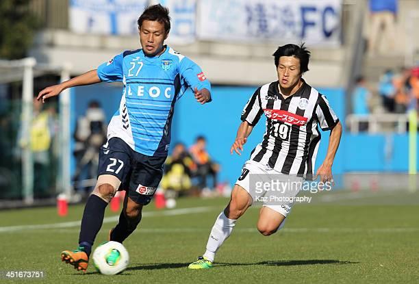 Takanori Nakajima of Yokohama FC and Yuki Yamamura of Mito Hollyhock compete for the ball during the JLeague second division match between Yokohama...