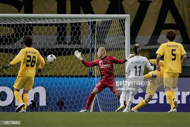 Takanori Sugeno of Kashiwa Reysol makes a fine save from a Neymar of Santos during the FIFA Club World Cup semi final match between Kashiwa Reysol...