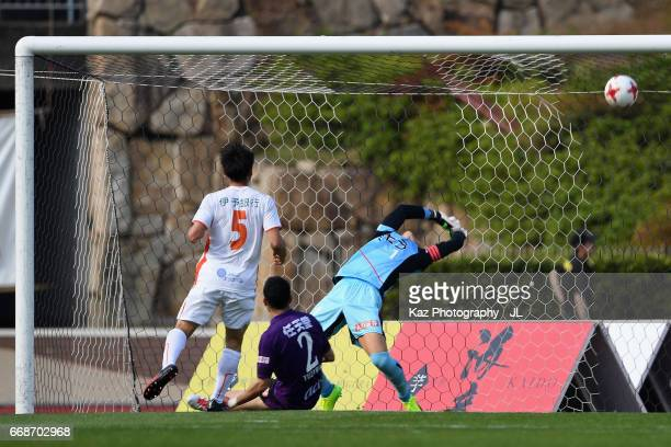 Takanori Sugeno of Kyoto Sanga unable to stop the shot by Takashi Kondo of Ehime FC to allow the opening goal to Ehime FC during the JLeague J2 match...