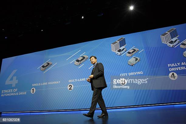 Takao Asami senior vice president of research and development at Nissan Motor Co speaks during the 2017 Consumer Electronics Show in Las Vegas Nevada...