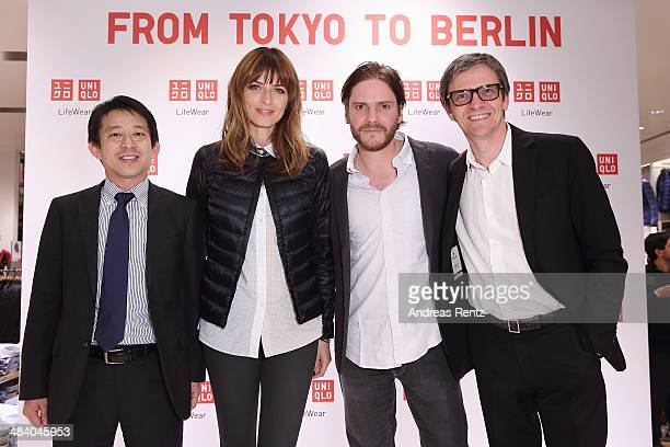 Takao Kuwahara COO Uniqlo Europe Eva Padberg Daniel Bruehl and Berndt Hauptkorn CEO Uniqlo Europe attend the Uniqlo PreOpening Party on April 10 2014...