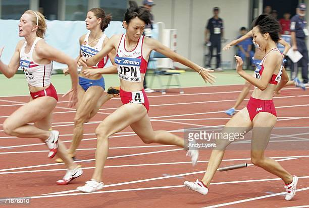 Takarako Nakamura of Japan reaches back for the dropped baton as Chisato Fukushima reacts to the drop in the first round of the Womens 4x100 Meters...