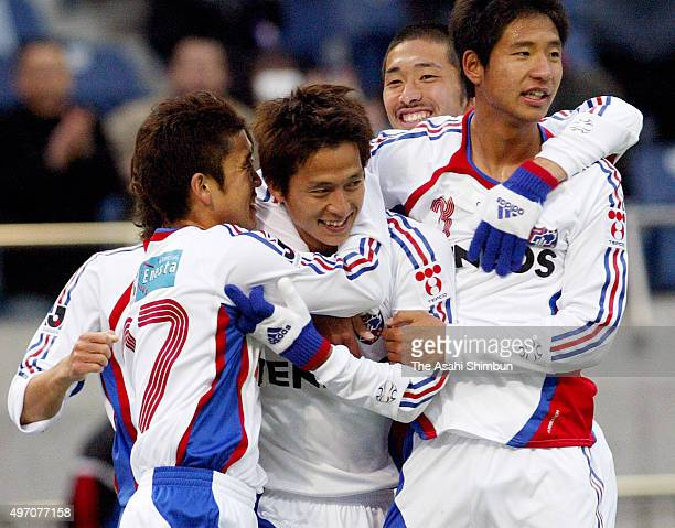 Takashi Fukunishi of FC Tokyo celebrates scoring his team's second goal with his team mates during the JLeague match between Omiya Ardija and FC...