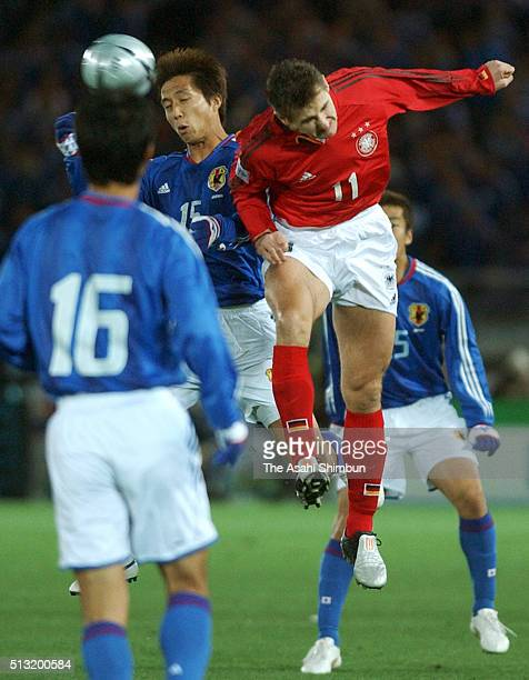 Takashi Fukunishi of Japan and Miroslav Klose of Germany compete for the ball during the international friendly match between Japan and Germany at...