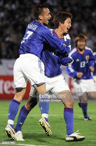 Takashi Fukunishi of Japan celebrates scoring his team's first goal with his team mate Hidetoshi Nakata during the Germany World Cup Aisan Qualifier...
