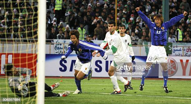 Takashi Fukunishi of Japan celebrates scoring his team's first goal during the Germany World Cup Aisan Qualifier Third Round match between Iran and...