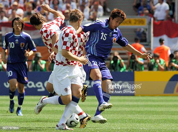 Takashi Fukunishi of Japan competes against Croatia defense during the FIFA World Cup Germany 2006 Group F match between Japan and Croatia at the...