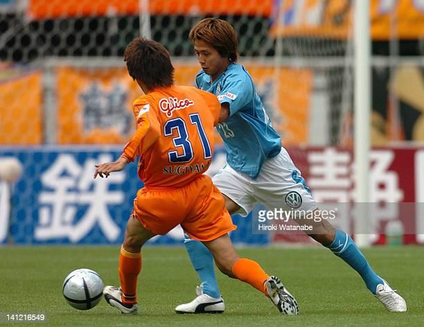 Takashi Fukunishi of Jubilo Iwata and Kota Sugiyama of Shimizu SPulse compete for the ball during the JLeague match between Shimizu SPulse and Jubilo...