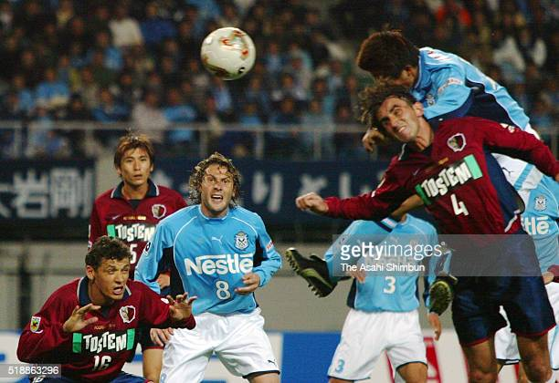 Takashi Fukunishi of Jubilo Iwata heads the ball to score his team's second goal during the JLeague match between Jubilo Iwata and Kashima Antlers at...