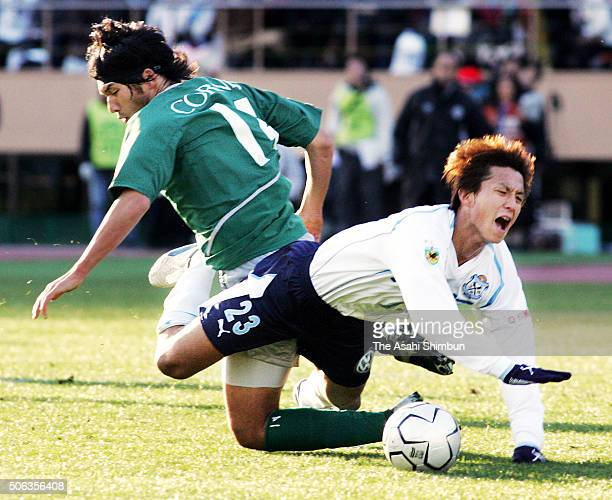 Takashi Fukunishi of Jubilo Iwata is challenged by Seitaro Tomisawa of Tokyo Verdy during the 84th Emperor's Cup Final between Tokyo Verdy 1969 and...